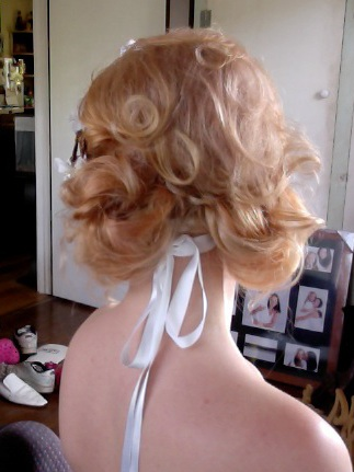 soft curls pinned loosely at the back, a very cute wedding hairstyle, perfect for a tropical beach destination wedding or an elopement
