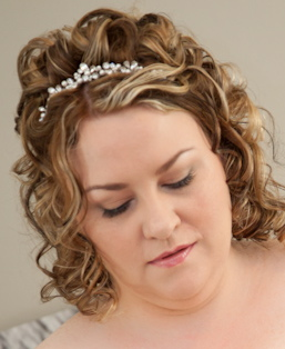 curly hair controlled with hot rollers to add definition to your natural curl, half up half down and piecy for the perfect bridal hairstyle, finished with a pearl tiara
