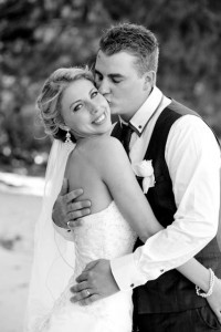 Kellie and Kyron's Port Douglas wedding makeup and bridal hair, beach wedding makeup and bridal hairstyling, the groom kisses his stunning bride, her eyes look amazing thanks to the makeup