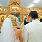 bride and groom white wedding suit cairns greek orthodox church service