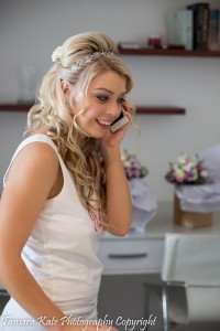 bride phones a friend on her wedding day palm cove cairns wedding hair and bridal makeup sml