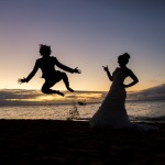 jumping jack bride and groom sunset beach wedding green island hair and makeup artist