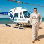 the groom arrives by helicopter for beach wedding at palm cove cairns